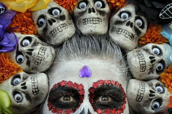Maricela Flores Dominguez with her skull headdress during the  Unity Council's 21st annual Dia de los Muertos celebration in the Fruitvale district of Oakland, Calif., on Sunday, October 30, 2016.
