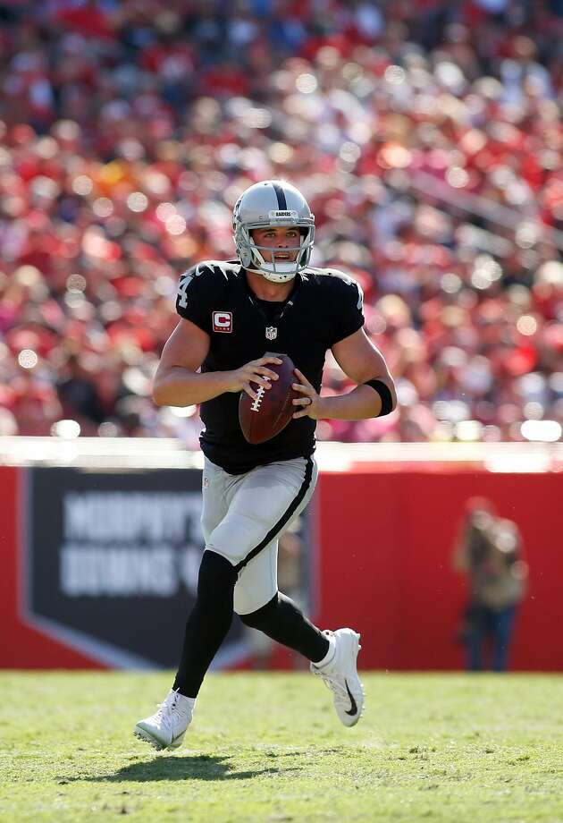 Derek Carr helped the Raiders overcome 23 penalties by throwing for a franchise single-game record 513 yards, on 40 or 59 passing, and four touchdowns, including the game-winner in OT. Photo: Brian Blanco, Getty Images