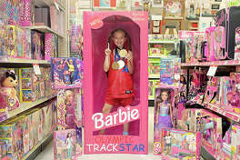 "TRACK & FIELD BARBIE: Molly says this was ""all her idea."" Excellent execution of this Barbie, and the toy store photo composition is A++."