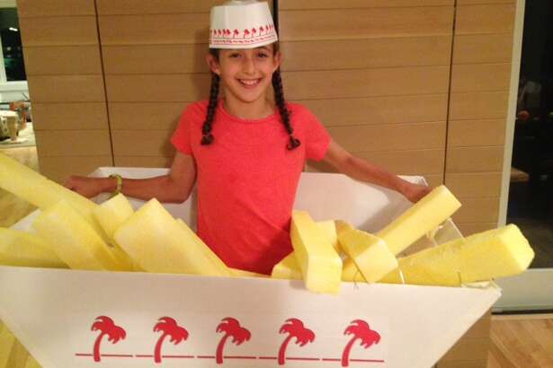 IN-AND-OUT FRENCH FRIES: D. Pepp sends this photo of her daughter dressed as In-and-Out Burger french fries. She should get them free for life.