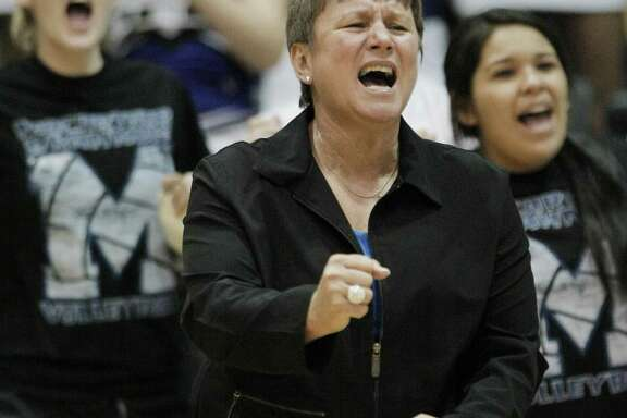 MacArthur head coach Margaret Mitcham yells during the Region IV-5A final against Corpus Christi King High School, Saturday, Nov. 13, 2010, at St. Mary's University in San Antonio. King beat MacArthur in three straight matches to advance to the state championship semi-final. (Darren Abate/Special to the Express-News)