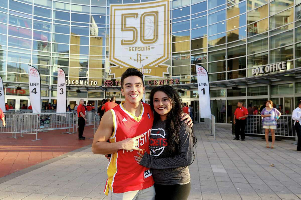Fans pose for a photo at Toyota Center before the Houston Rockets takes on Dallas Mavericks for the home opener Sunday, Oct. 30, 2016, in Houston.