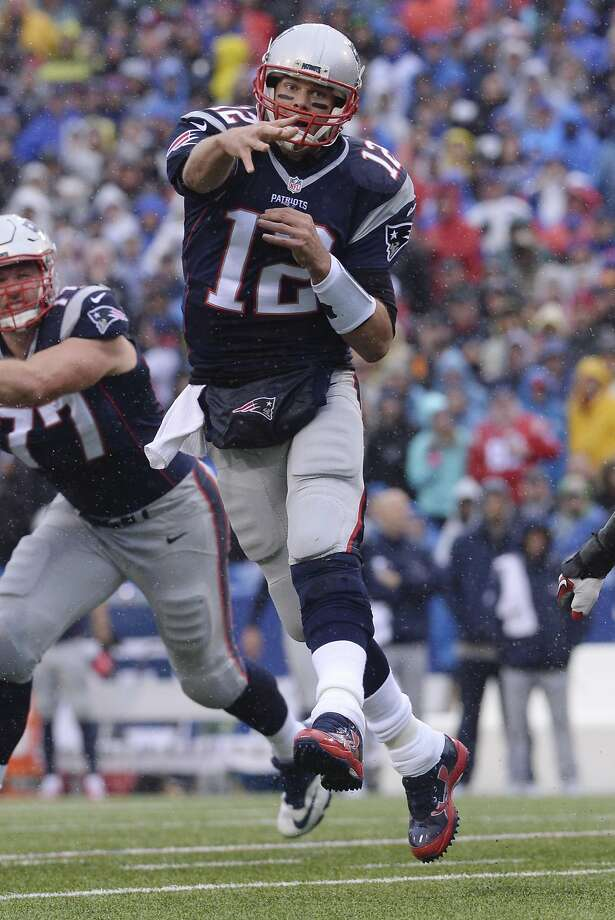 The Patriots' Tom Brady threw for four touchdowns. Photo: Adrian Kraus, Associated Press