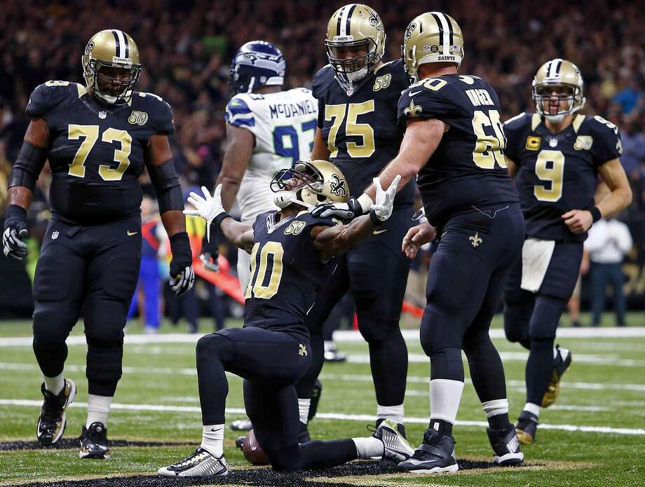 Saints wide receiver Brandin Cooks celebrates after his 2-yard touchdown reception early in the fourth quarter gave his team the lead for good against the Seahawks. Photo: Butch Dill, Associated Press