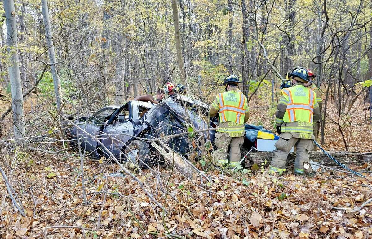 State police are investigating a Thruway crash that resulted in a rollover into a wooden area Sunday morning. Both passengers had to be extricated from the vehicle and were transported to Albany Medical Center. (Tom Heffernan Sr. photo)