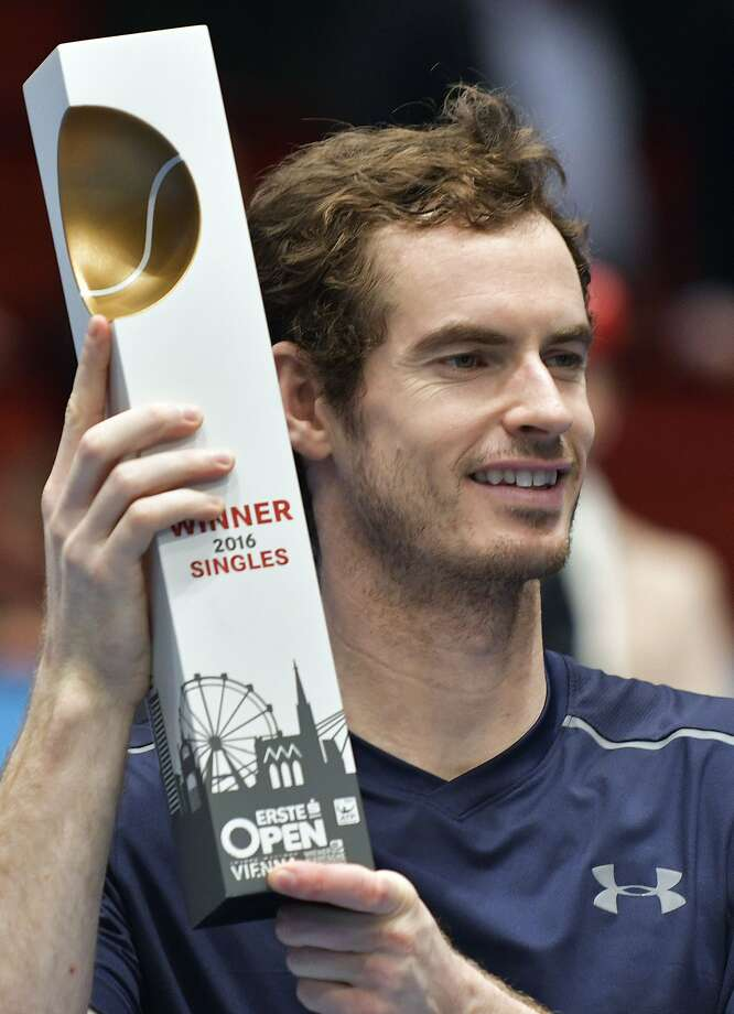 Winner Andy Murray of Great Britain (R) poses after the final match against Jo-Wilfried Tsonga of France at the ATP Erste Bank Open Tennis tournament in Vienna, on October 30, 2016.  / AFP PHOTO / APA / HANS PUNZ / Austria OUTHANS PUNZ/AFP/Getty Images Photo: HANS PUNZ, AFP/Getty Images