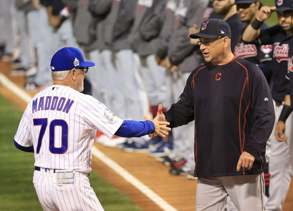 Chicago Cubs manager Joe Maddon shakes hands with Cleveland Indians manager Terry Francona before Game 3 of the Major League Baseball World Series Friday, Oct. 28, 2016, in Chicago. (AP Photo/Tannen Maury, Pool)