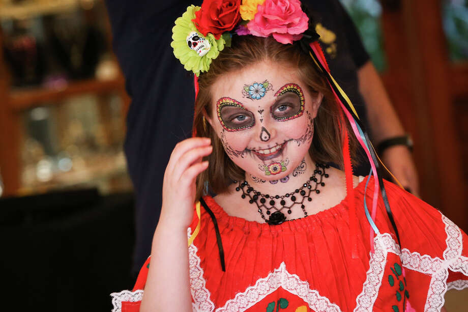 Isabella Hays, 8, smiles while exiting the Conroe Art League Gallery during a trick or treat event on Saturday, Oct. 29, 2016, in downtown Conroe. Photo: Michael Minasi/ Houston Chronicle