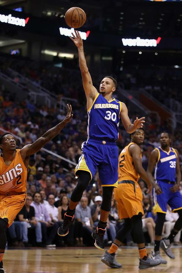 PHOENIX, AZ - OCTOBER 30:  Stephen Curry #30 of the Golden State Warriors puts up a shot over Eric Bledsoe #2 of the Phoenix Suns  during the first half of the NBA game at Talking Stick Resort Arena on October 30, 2016 in Phoenix, Arizona.  NOTE TO USER: User expressly acknowledges and agrees that, by downloading and or using this photograph, User is consenting to the terms and conditions of the Getty Images License Agreement.  (Photo by Christian Petersen/Getty Images) Photo: Christian Petersen, Getty Images