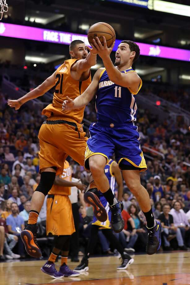 PHOENIX, AZ - OCTOBER 30:  Klay Thompson #11 of the Golden State Warriors lays up a shot over Alex Len #21 of the Phoenix Suns during the first half of the NBA game at Talking Stick Resort Arena on October 30, 2016 in Phoenix, Arizona.  NOTE TO USER: User expressly acknowledges and agrees that, by downloading and or using this photograph, User is consenting to the terms and conditions of the Getty Images License Agreement.  (Photo by Christian Petersen/Getty Images) Photo: Christian Petersen, Getty Images