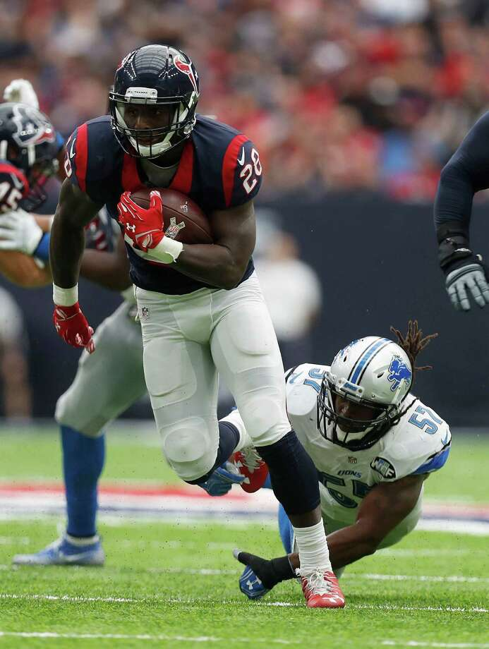 Texans running back Alfred Blue (28) rushed for 41 yards on nine carries, including a season high 19-yard scamper, en route to helping the offense close out the game on the ground. Photo: Karen Warren, Staff Photographer / 2016 Houston Chronicle