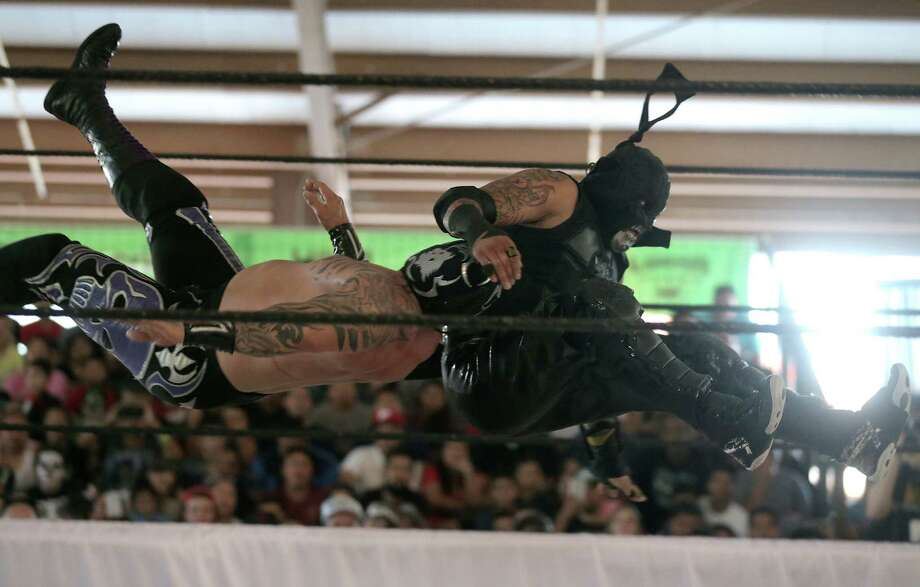 Lucha Underground wrestlers Pentagon Dark, right, and  Mil Muerters get tangled up during a match at Trader's Village on, Sunday, Oct. 30, 2016, in Houston. Photo: Elizabeth Conley, Houston Chronicle / © 2016 Houston Chronicle