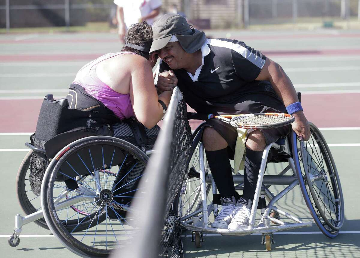 Amy Burnett of Nashville, Tenn., and Jesus Bahena of Houston congratulate each other during a wheelchair tennis match that was part of the University of Houston's adaptive tennis program's first USTA-sanctioned tournament Sunday at Memorial Park.