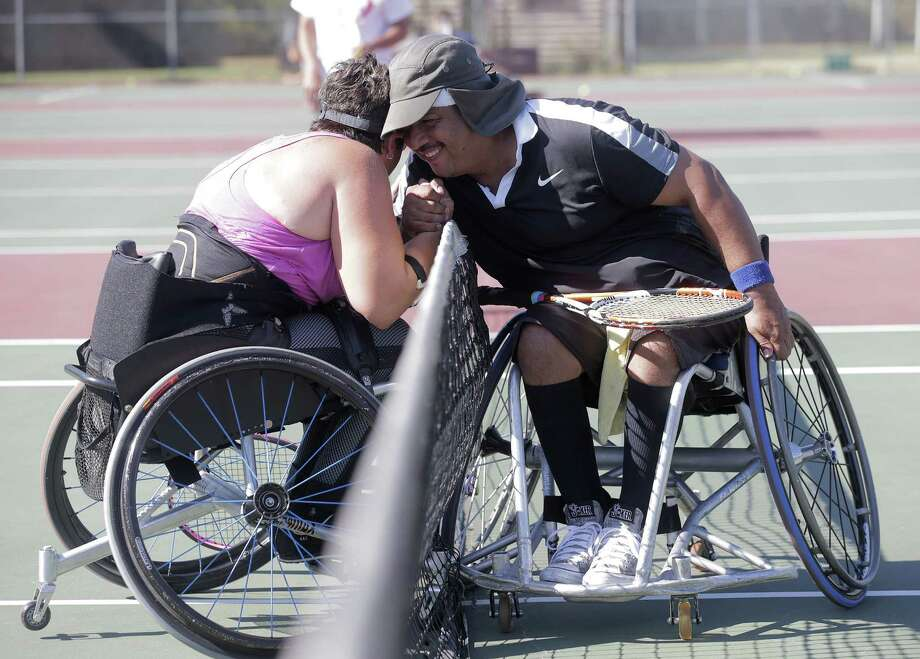 Amy Burnett of Nashville, Tenn., and Jesus Bahena of Houston congratulate each other during a wheelchair tennis match that was part of the University of Houston's adaptive tennis program's first USTA-sanctioned tournament Sunday at Memorial Park. Photo: Elizabeth Conley, Staff / © 2016 Houston Chronicle