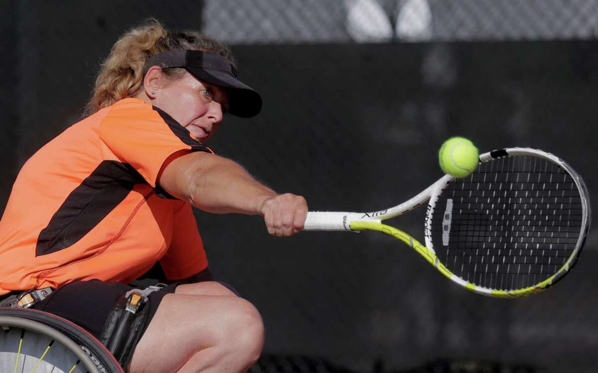 Lynn Seidemann of Del Ray Beach, Fla., returns a serve during Sunday's tournament at Memorial Park. Wheelchair tennis helps people with disabilities become independent in other areas of their lives, experts say.