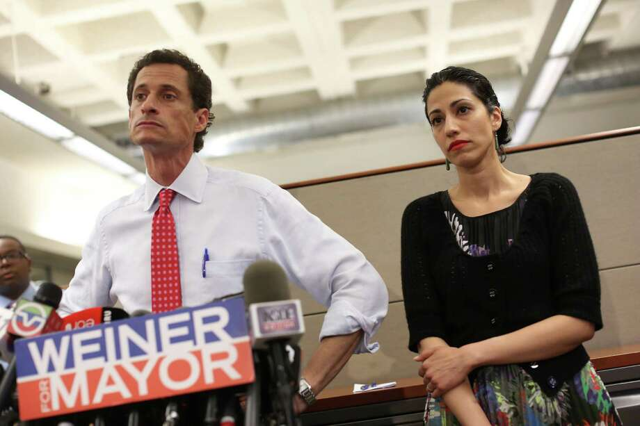 FILE é' Anthony Weiner, then running for mayor of New York, and his wife Huma Abedin during a news conference after a New York City tabloid published screen shots of sexual conversations Weiner allegedly had with another woman, July 23, 2013. Federal law enforcement officials said Friday, Oct. 28, 2016, that new emails uncovered in the closed investigation into Hillary Clintoné•s use of a private email server were discovered after the FBI seized electronic devices belonging to Abedin, a Clinton aide, and her husband, during investigation of messages Weiner is suspected of having sent to a 15-year-old girl in North Carolina. (Michael Appleton/The New York Times) Photo: Michael Appleton, STR / NYTNS