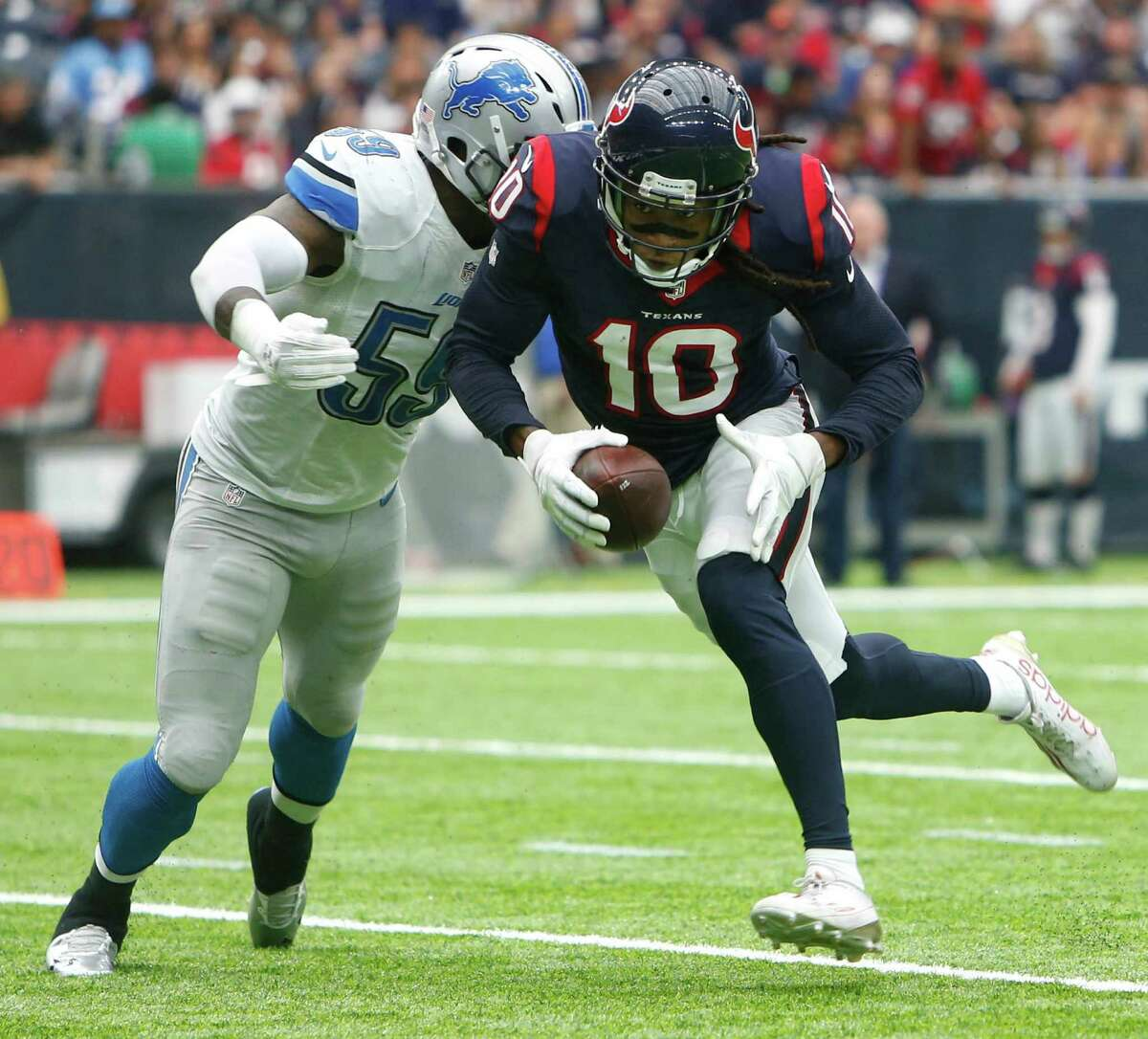 Houston Texans wide receiver DeAndre Hopkins (10) is hit by Detroit Lions middle linebacker Tahir Whitehead (59) on a reception near the goal line during the second quarter of an NFL football game at NRG Stadium on Sunday, Oct. 30, 2016, in Houston. ( Brett Coomer / Houston Chronicle )