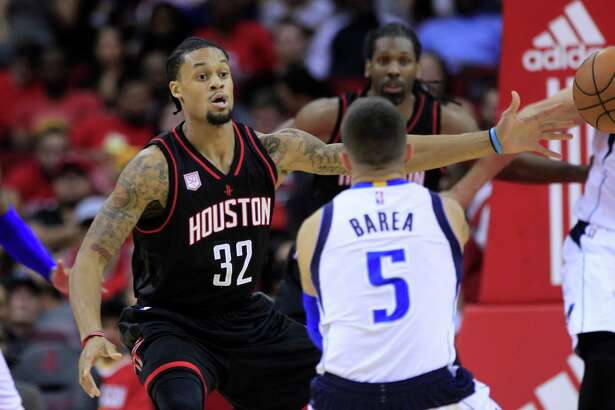 Houston Rockets guard K.J. McDaniels (32) guards Dallas Mavericks guard J.J. Barea (5) during the Houston Rockets game against the Dallas Mavericks at the Toyota Center, Sunday, Oct. 30, 2016, in Houston.