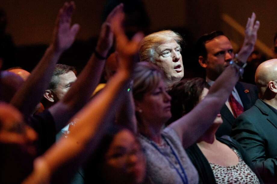 Donald Trump began his Sunday in Nevada, where he stopped by a service at the International Church of Las Vegas. He later campaigned in Colorado. Photo: Evan Vucci, STF / Copyright 2016 The Associated Press. All rights reserved.