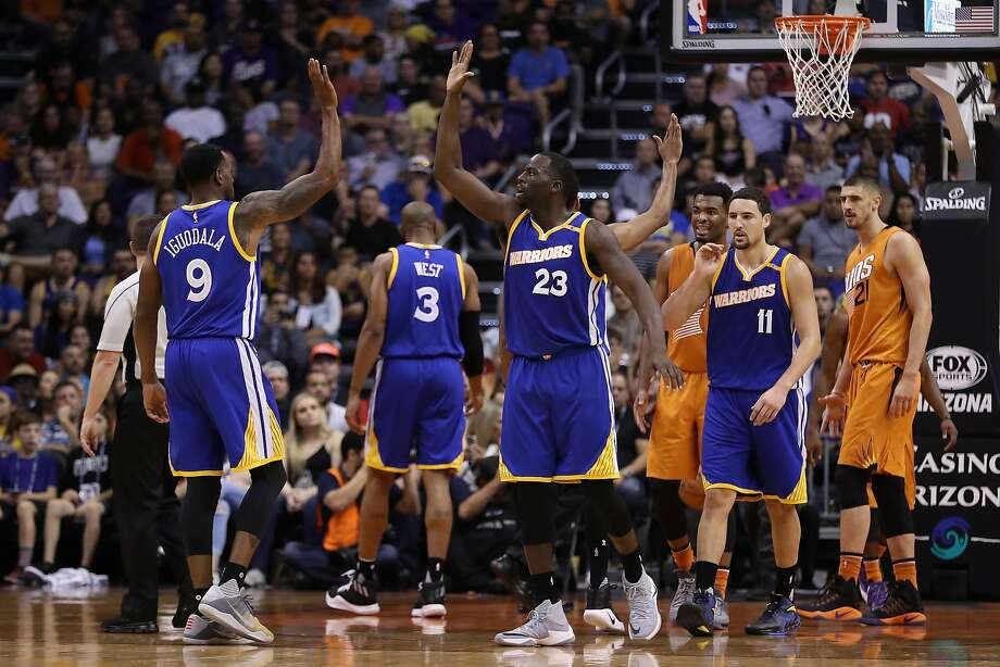 PHOENIX, AZ - OCTOBER 30:  Draymond Green #23 of the Golden State Warriors high fives Andre Iguodala #9 after scoring against the Phoenix Suns during the second half of the NBA game at Talking Stick Resort Arena on October 30, 2016 in Phoenix, Arizona.  The Warriors defeated the Suns 106 -100. NOTE TO USER: User expressly acknowledges and agrees that, by downloading and or using this photograph, User is consenting to the terms and conditions of the Getty Images License Agreement.  (Photo by Christian Petersen/Getty Images) Photo: Christian Petersen, Getty Images