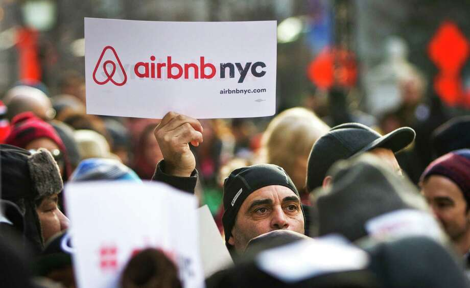 FILE - In this Jan. 20, 2015, file photo, supporters of Airbnb hold a rally outside City Hall in New York. Airbnb hosts in New York are worried about a new law that could lead to them being fined up to $7,500 for renting out their apartments. People who occasionally rent their living spaces for side income say they are getting unfairly swept up in a law aimed mostly at commercial operators. Airbnb has filed a lawsuit to block the law. (AP Photo/Bebeto Matthews, File) ORG XMIT: NYBM102 Photo: Bebeto Matthews / Copyright 2016 The Associated Press. All rights reserved. This m