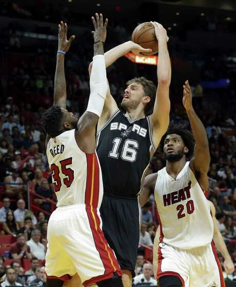 San Antonio's Pau Gasol (16) had 20 points and 11 rebounds as the Spurs came to life on offense and held off Miami in the closing minutes Sunday night. Photo: Lynne Sladky, STF / Copyright 2016 The Associated Press. All rights reserved.
