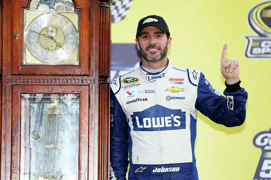 MARTINSVILLE, VA - OCTOBER 30:  Jimmie Johnson, driver of the #48 Lowe's Chevrolet, celebrates with the trophy in Victory Lane after winning the NASCAR Sprint Cup Series Goody's Fast Relief 500 at Martinsville Speedway on October 30, 2016 in Martinsville, Virginia.  (Photo by Jerry Markland/Getty Images) Photo: Jerry Markland, Stringer / 2016 Getty Images