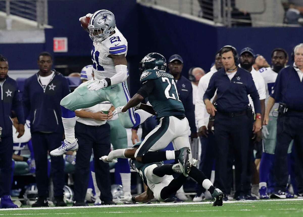 ARLINGTON, TX - OCTOBER 30: Ezekiel Elliott #21 of the Dallas Cowboys runs the ball against Rodney McLeod #23 of the Philadelphia Eagles in the second quarter during a game between the Dallas Cowboys and the Philadelphia Eagles at AT&T Stadium on October 30, 2016 in Arlington, Texas. (Photo by Ronald Martinez/Getty Images)