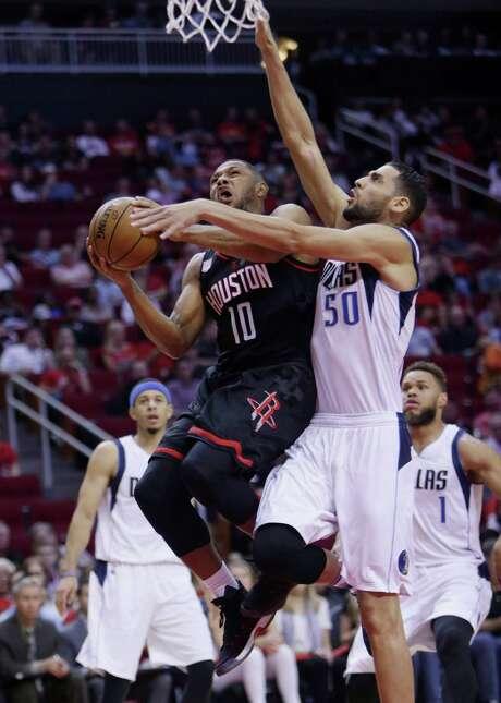 Rockets guard Eric Gordon (10) drives past Dallas center Salah Mejri (50). Photo: Mark Mulligan, Staff / © 2016 Houston Chronicle
