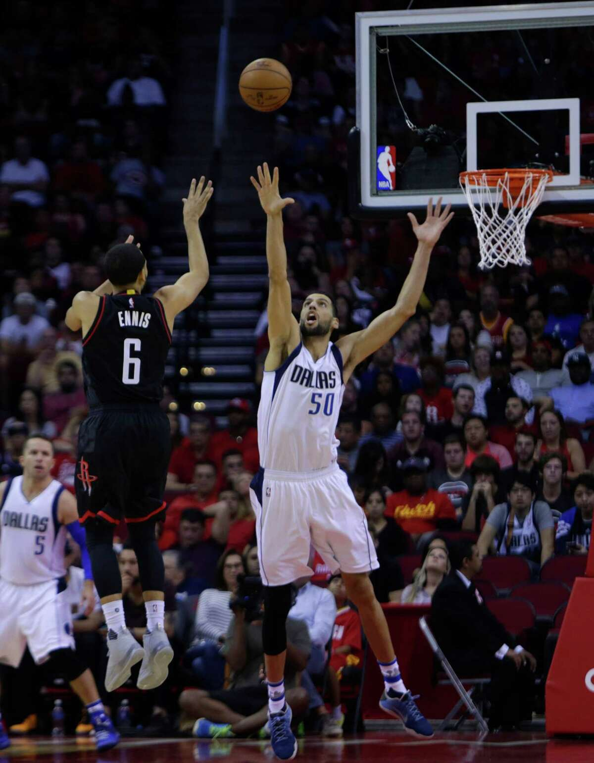 Houston Rockets guard Tyler Ennis (6) shoots over Dallas Mavericks center Salah Mejri (50) during the Houston Rockets game against the Dallas Mavericks at the Toyota Center, Sunday, Oct. 30, 2016, in Houston.
