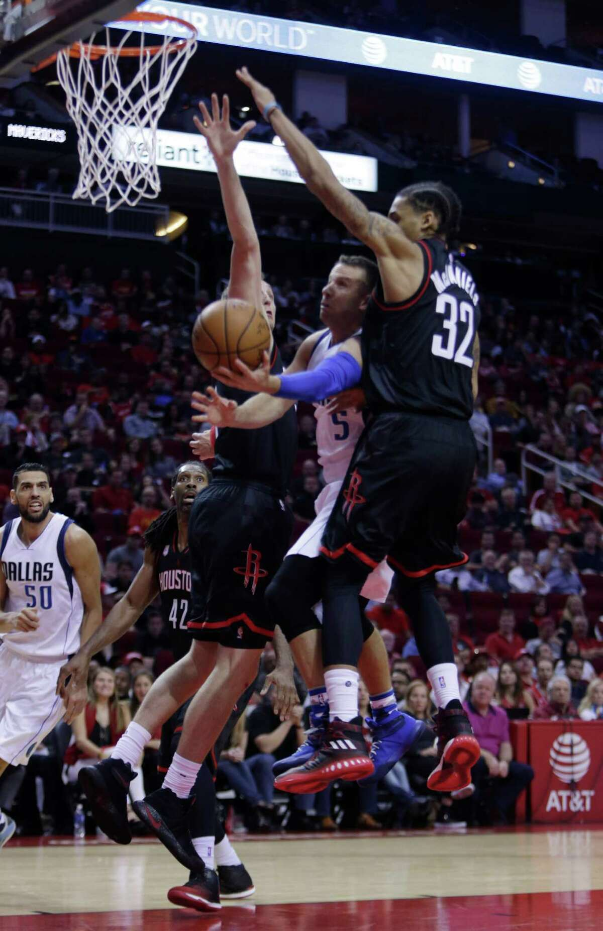 Houston Rockets guard K.J. McDaniels (32) goes up to eventually block a Dallas Mavericks guard J.J. Barea (5) shot during the Houston Rockets game against the Dallas Mavericks at the Toyota Center, Sunday, Oct. 30, 2016, in Houston.