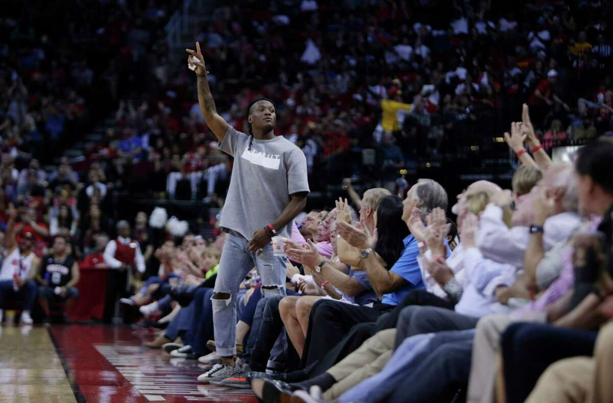 Texans wide receiver DeAndre Hopkins waves to the crowd during the Houston Rockets game against the Dallas Mavericks at the Toyota Center, Sunday, Oct. 30, 2016, in Houston.