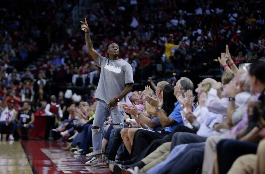 Texans wide receiver DeAndre Hopkins waves to the crowd during the Houston Rockets game against the Dallas Mavericks at the Toyota Center, Sunday, Oct. 30, 2016, in Houston. Photo: Mark Mulligan, Houston Chronicle / © 2016 Houston Chronicle