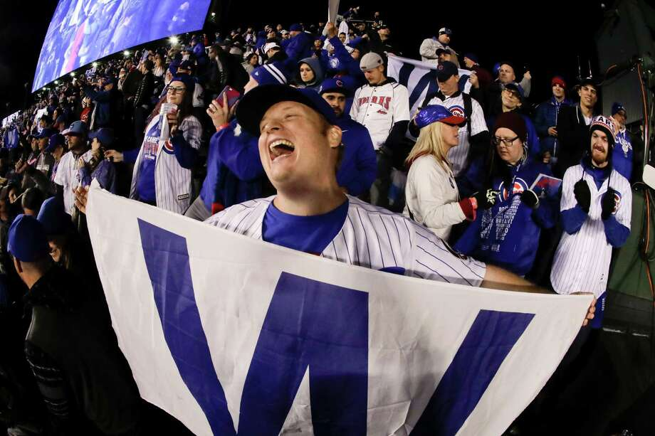 Fans cheer after the Chicago Cubs won Game 5 of the Major League Baseball World Series against the Cleveland Indians Sunday, Oct. 30, 2016, in Chicago. The Cubs won 3-2 as the Indians lead the series 3-2. (AP Photo/Charlie Riedel) Photo: Charlie Riedel, Associated Press / Copyright 2016 The Associated Press. All rights reserved.