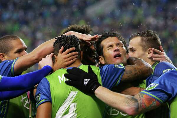 Teammates celebrate with Nelson Valdez (facing) after he scored the first goal of the game for the Sounders during the second half of game 1 of the Western Conference semifinals between the Seattle Sounders and FC Dallas, Sunday, Oct. 30, 2016 at CenturyLink Field.