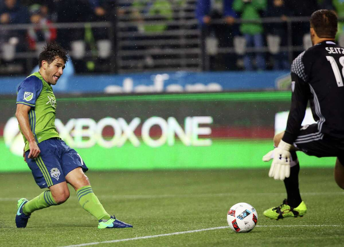 Seattle's Nicolas Lodeiro puts the ball past Dallas goal keeper Chris Seitz to score his second goal of the game during the second half of game 1 of the Western Conference semifinals between the Seattle Sounders and FC Dallas, Sunday, Oct. 30, 2016 at CenturyLink Field.