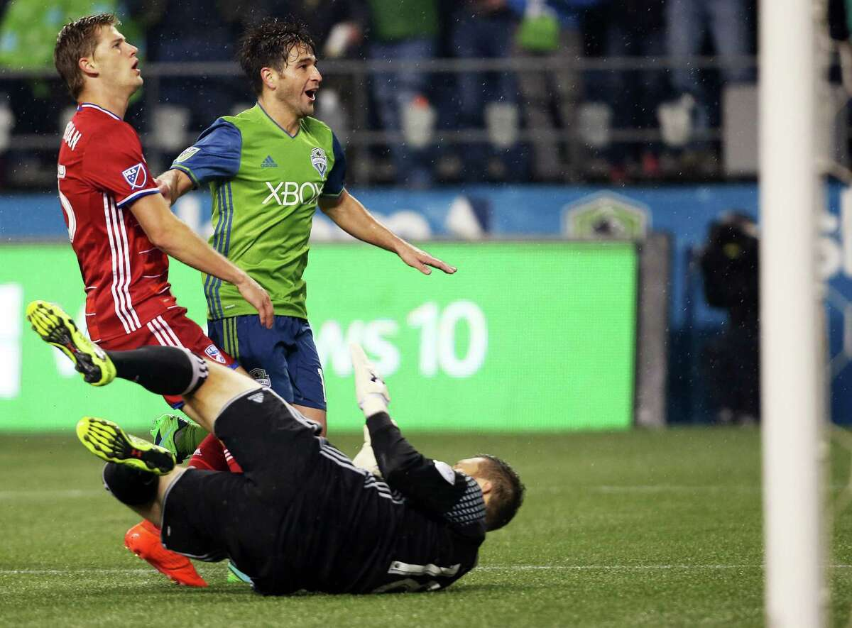Seattle's Nicolas Lodeiro (center) reacts after putting the ball past Dallas goal keeper Chris Seitz to score his second goal of the game during the second half of game 1 of the Western Conference semifinals between the Seattle Sounders and FC Dallas, Sunday, Oct. 30, 2016 at CenturyLink Field.