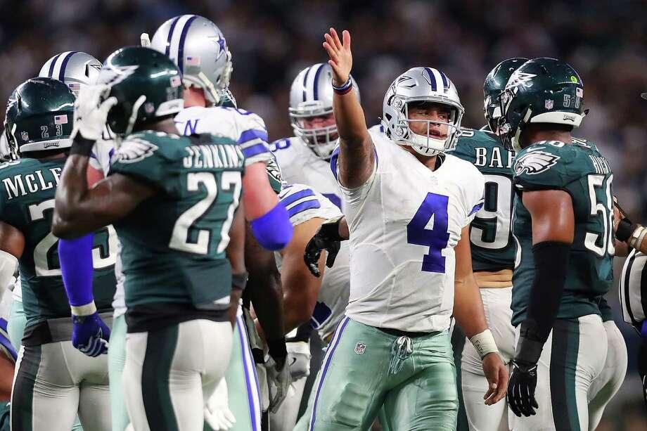 0f09114fcb9 ARLINGTON, TX - OCTOBER 30: Dak Prescott #4 of the Dallas Cowboys celebrates