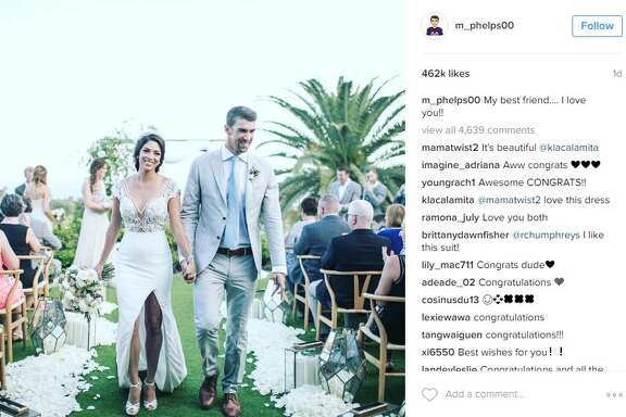 """Olympic swimmer Michael Phelps posted this photo to Instagram with the caption, """"My best friend.... I love you!!"""" after getting married to Nicole Johnson."""