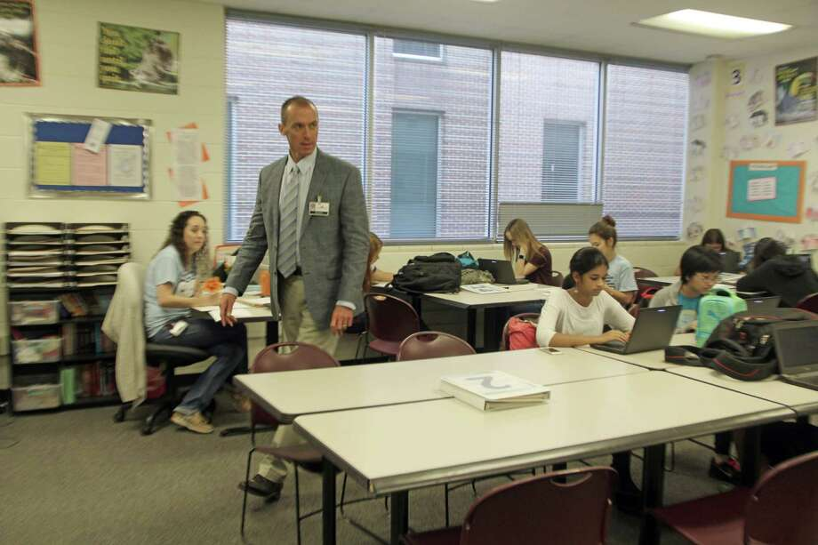 """Brett Lemley,principal of Clear Horizon Early College High School, visits with students. """"Our approach is unique in that we've created a freshman class that stays together all the way through high school,"""" he says. Photo: Kristi Nix"""