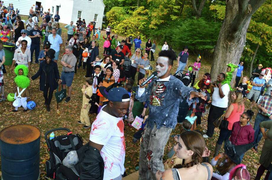 Paul Herman, of Double Up Dance Studio, gets the crowd excited at the Halloween on the Green event at Town Hall on Sunday in Fairfield. Photo: Jarret Liotta / For Hearst Connecticut Media / Fairfield Citizen News Freelance