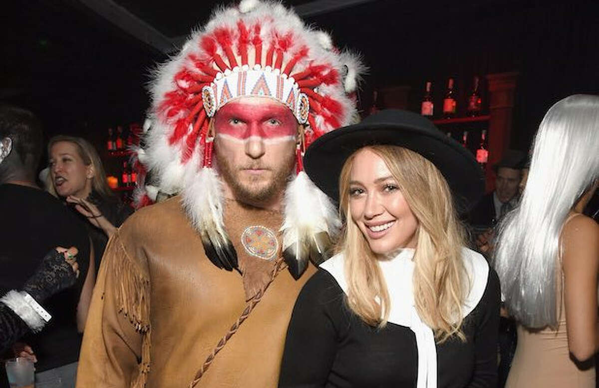 Hillary Duff and her boyfriend, trainer Jason Walsh were blasted for their couple's pilgrim and Native American Indian costume.