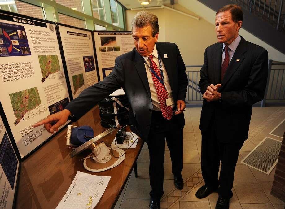 Connecticut Agricultural Experiment Station Director Theodore Andreadis, left, points to a map showing cases of West Nile Virus to Senator Richard Blumenthal during his visit to the facility in New Haven, Conn. on Tuesday, August 30, 2016. The state announced Monday that it was ending mosquito trapping and testing for the season. Photo: Brian A. Pounds / Hearst Connecticut Media / Connecticut Post