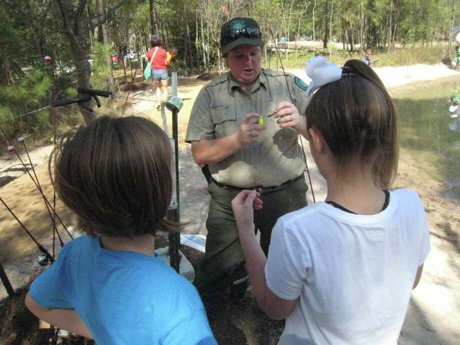 The groves celebrates opening of fish camp pond houston for Sheldon lake fishing