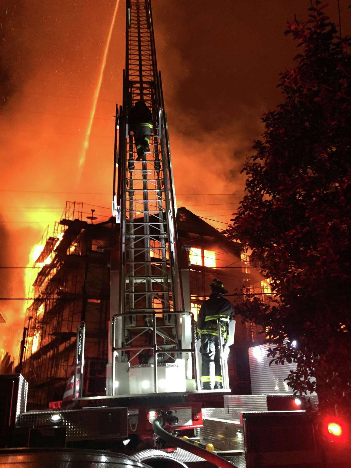 A 5-alarm fire gutted a unfinished three-story apartment complex east of Oakland's Lake Merritt on Monday morning.