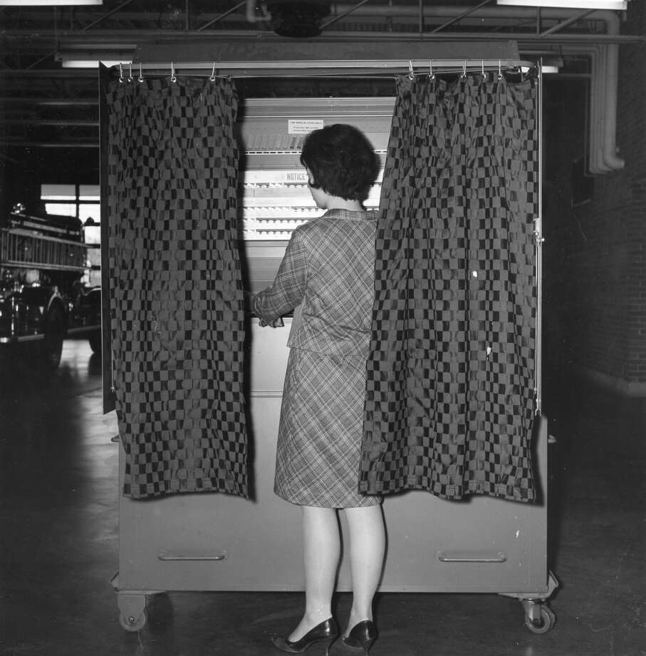 Voting machine at the fire station. 1964 Photo: Daily News File Photo