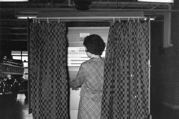 Voting machine at the fire station. 1964