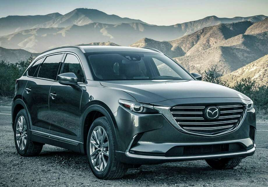 Mazda's three-row midsize crossover utility vehicle, the CX-9, has been completely redesigned for 2016, and has a starting price of $31,520 (plus $900 freight). It's available in four trim levels, and all-wheel drive is optional (included on the top version). / 2015