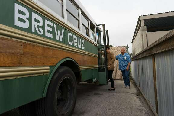 Terry Beatty prepares to board the Brew Cruz after stopping at Santa Cruz Mountain Brewing in Santa Cruz, Calif. on Saturday, Oct. 29, 2016. The Brew Cruz takes guests to several breweries in Santa Cruz and offers a brief history lesson with each stop.