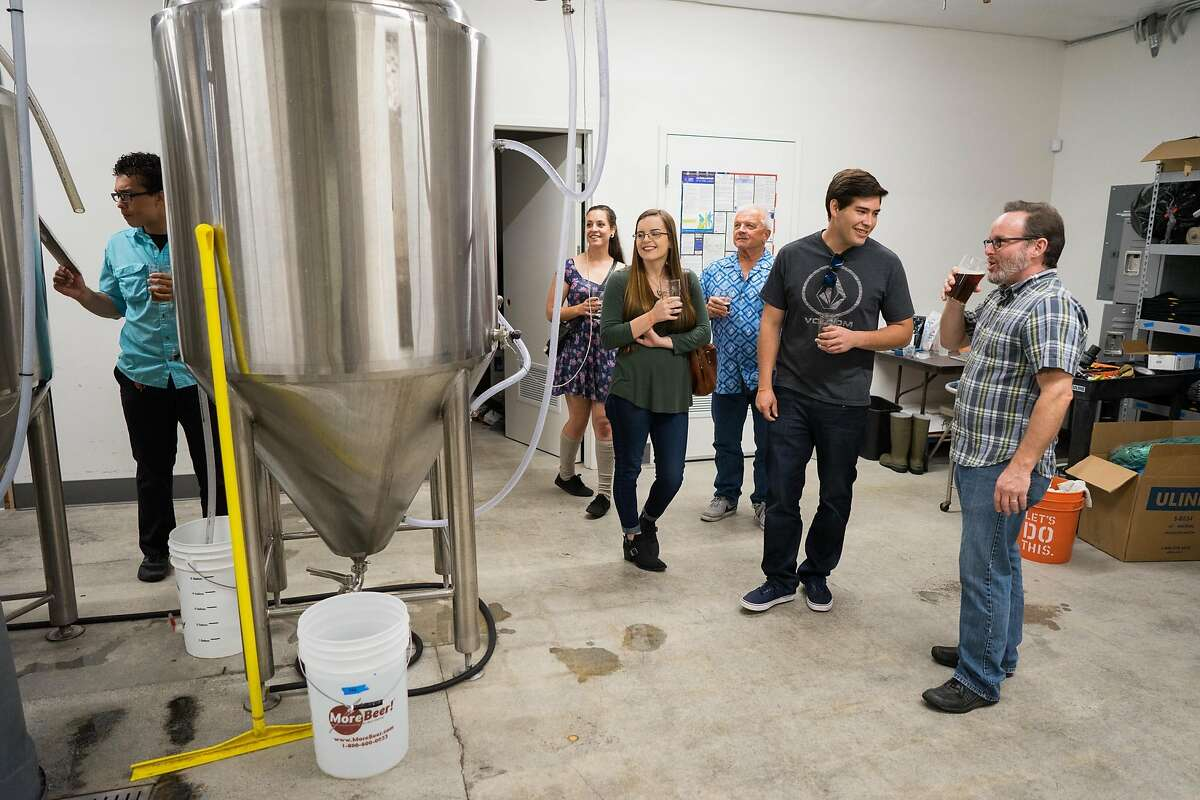 James Hrica, right, of East Cliff Brewing gives a tour in Santa Cruz, Calif. on Saturday, Oct. 29, 2016. East Cliff Brewing serves British style ales.